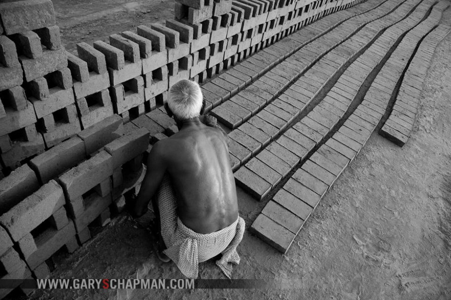 "The backbreaking work of a brick-maker is one of the few jobs available to Christians in Pakistan.  The majority have limited educational opportunities. Their high illiteracy rate leaves them restricted mostly to menial jobs.  Male, 75 years old, brick-maker. For $2.60 per day, this laborer must produce 1,000 bricks. To meet his quota of bricks, a brick-maker is often forced to have his entire family working. ""Being a Christian is not an easy way to go. It is a hard, challenging life. Sometimes the owner is not giving us full wages. But Jesus is keeping us in His safe hands. Jesus told the downtrodden to come and He will give them rest.""  Pg 20, Worker and brick kiln. Pg 21, Prayer with pastor."